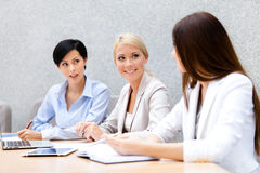 Female colleagues review business plan Stock Images