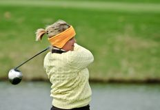 Female college golfer Stock Image