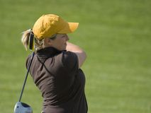 Female College Golfer Swinging Fairway Wood stock images
