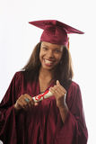 Female college graduate in cap and gown royalty free stock photo