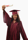 Female college graduate in cap and gown stock photography