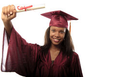 Female college graduate in cap and gown royalty free stock photography