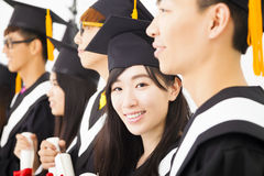 Female college graduate at graduation with classmates Stock Images