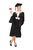 Female college graduate holding a diploma Stock Photo