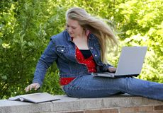Female college student. One young woman college student studying at school Stock Image
