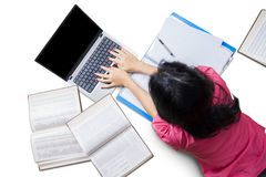 Female College Student Doing her Homework Stock Photos