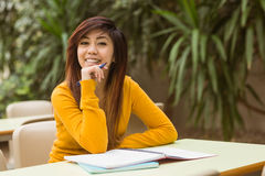 Female college student doing homework Royalty Free Stock Photography