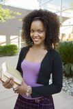 Female College Student Holding Books Stock Photography