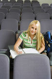 Female College Student In Lecture Room Stock Photography