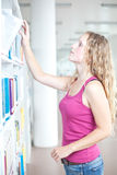 Female college student in a library Stock Photography