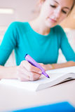 Female college student in a library Royalty Free Stock Photography