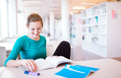 Female college student in a library Stock Photos