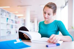Female college student in a library Stock Images
