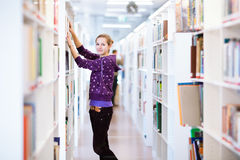 Female college student in a library. (shallow DOF; color toned image Royalty Free Stock Photo