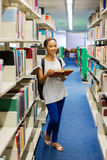 Female college student library Royalty Free Stock Photography