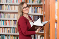 Female College Student In A Library Stock Photo
