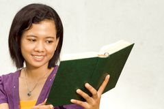 Female college student read a book Royalty Free Stock Image