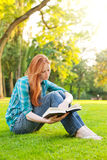 A Female College Student Reading a Book Royalty Free Stock Photos