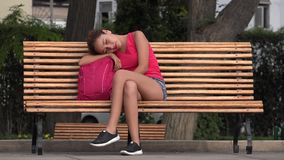 Female College Student Resting On Park Bench. A pretty young hispanic woman stock video footage