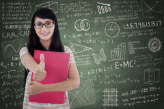 Female college student showing OK sign Stock Photography