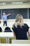 Female college student sitting in a classroom Stock Photos