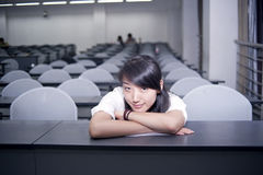 Female college student sitting in the classroom. Female students of the teacher Royalty Free Stock Image
