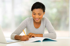 Female college student studying. Happy african female college student studying Royalty Free Stock Photo