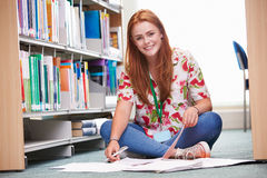 Female College Student Studying In Library Stock Photography