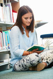 Female College Student Studying In Library Stock Image