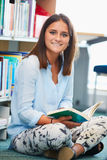 Female College Student Studying In Library Royalty Free Stock Images