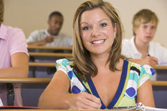 Female college student in a university lecture Royalty Free Stock Images