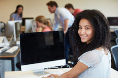 Female College Student Using Computer In Classroom Stock Photos