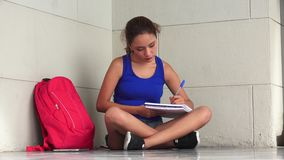 Female College Student Writing And Studying. A pretty young hispanic woman stock video footage