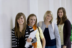 Female College Students. A group of attractive female college students smiling on their way to class royalty free stock photography