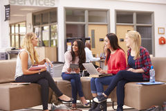 Female College Students Sitting And Talking Together Royalty Free Stock Photography