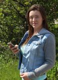 Female College/University Student Outdoors, Holding Cell Phone Mobile Phone Royalty Free Stock Photos