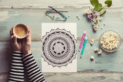 Female coloring adult coloring books, new stress relieving trend Royalty Free Stock Photos