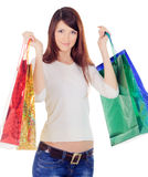 Female with colour shopping bags over white Royalty Free Stock Photos