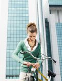 Female commuter. Locking padlock to her bike. Copy space Stock Photography