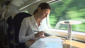Female Commuter On Train Working On Document stock video footage