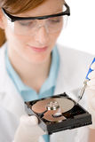 Female computer engineer - woman repair hard disc Stock Photography