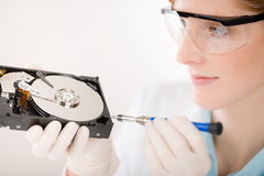 Female computer engineer - woman repair hard disc Stock Photos