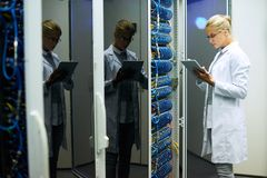 Female Computer Scientist Working in Data Center