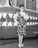 Female conductor standing in front of a tour trolley Royalty Free Stock Images