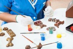 Female confectioner paint Stock Photos