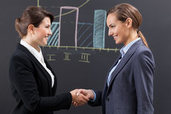 Female congratulations after presentation Royalty Free Stock Photo