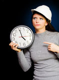 Female Construction Builder Pointing At Clock Royalty Free Stock Images
