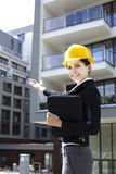 Female construction engineer show building Stock Photography
