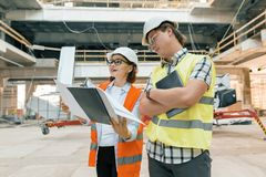 Female construction inspector examining construction site. Building, development, teamwork and people concept.  stock image
