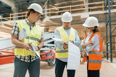 Female construction inspector examining construction site. Building, development, teamwork and people concept.  royalty free stock photography